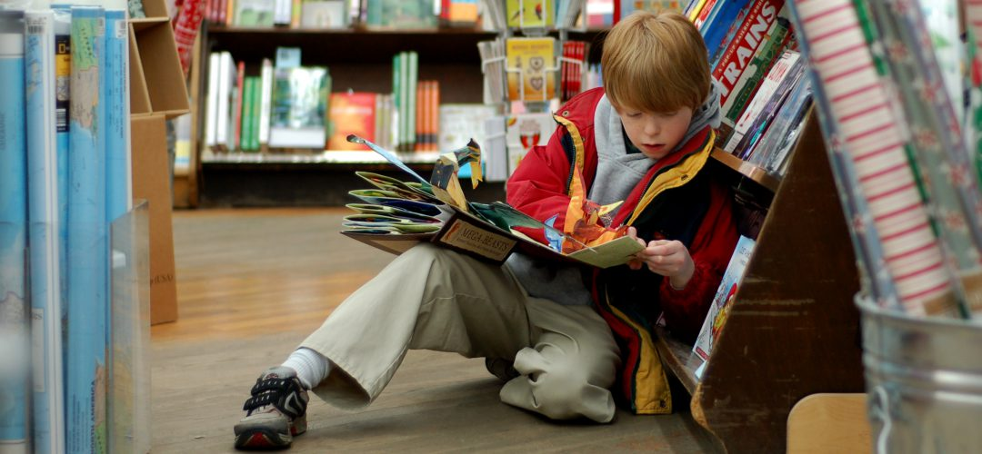 cropped-child_reading_at_brookline_booksmith.jpg